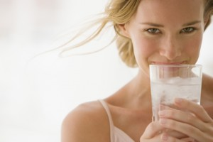 Confident woman drinking Culligan water